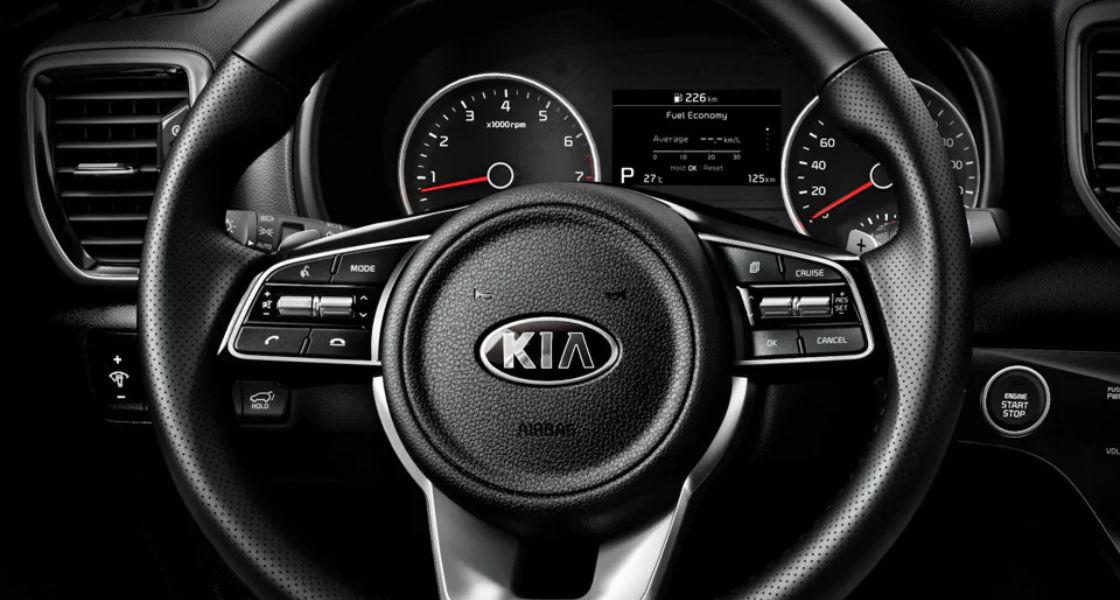 kia sportage interior control audio en el volante
